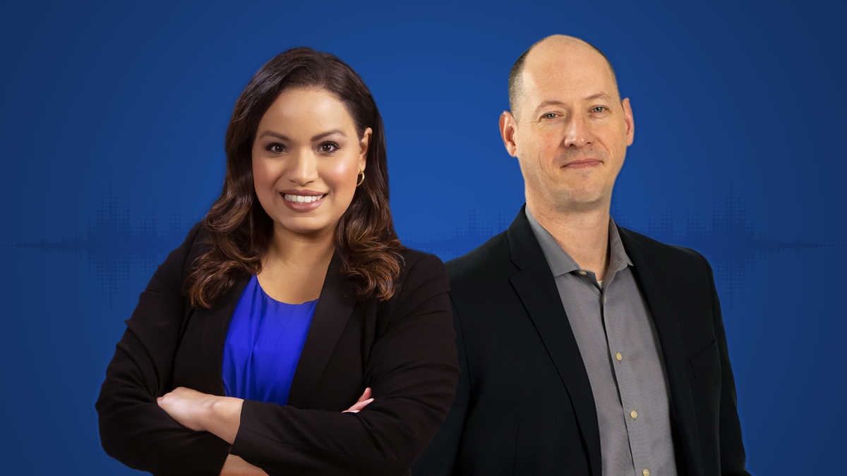 Lisa Peña and Brandon Nance against a solid blue background
