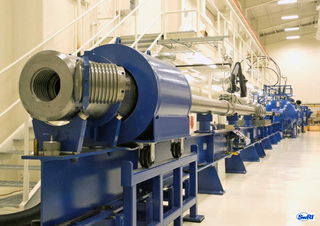SwRI's 72-feet-long two-stage light gas gun in a test lab
