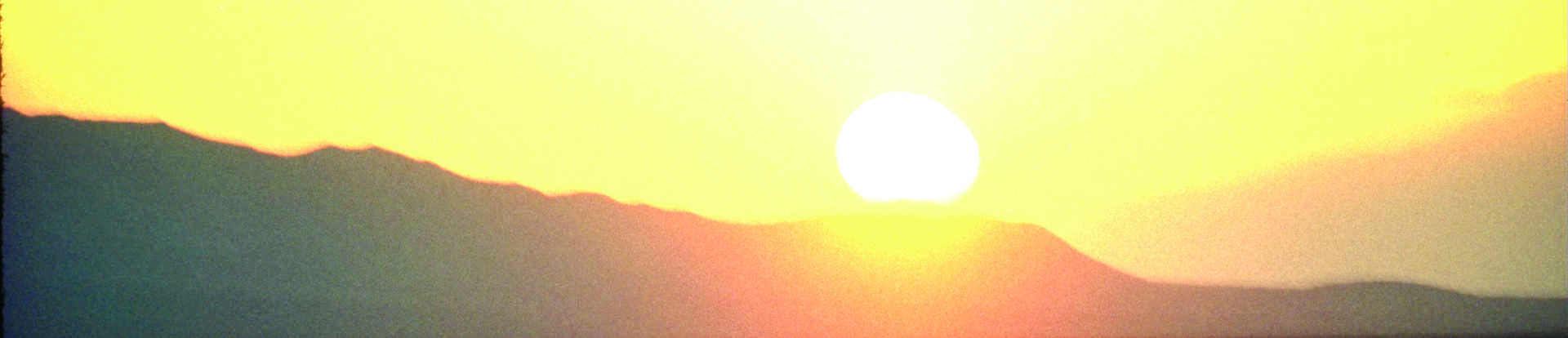 Sunrise trhough a moutain pass