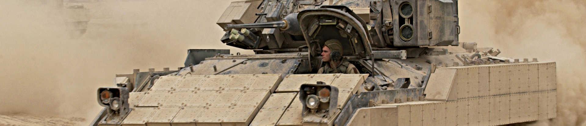 Bradley tank in motion across sand