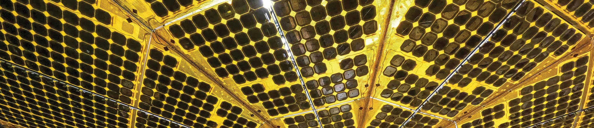 The underside of one of Lucy spacecraft's massive solar arrays in a thermal vacuum chamber