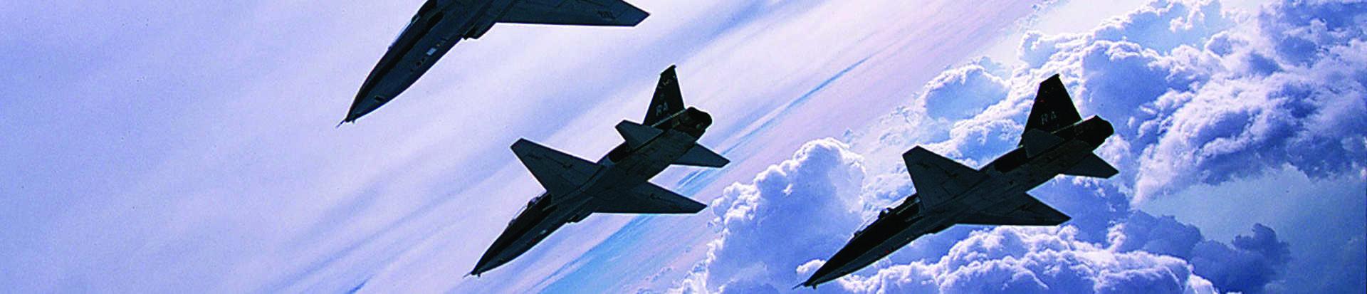 Fighter aircraft in flight