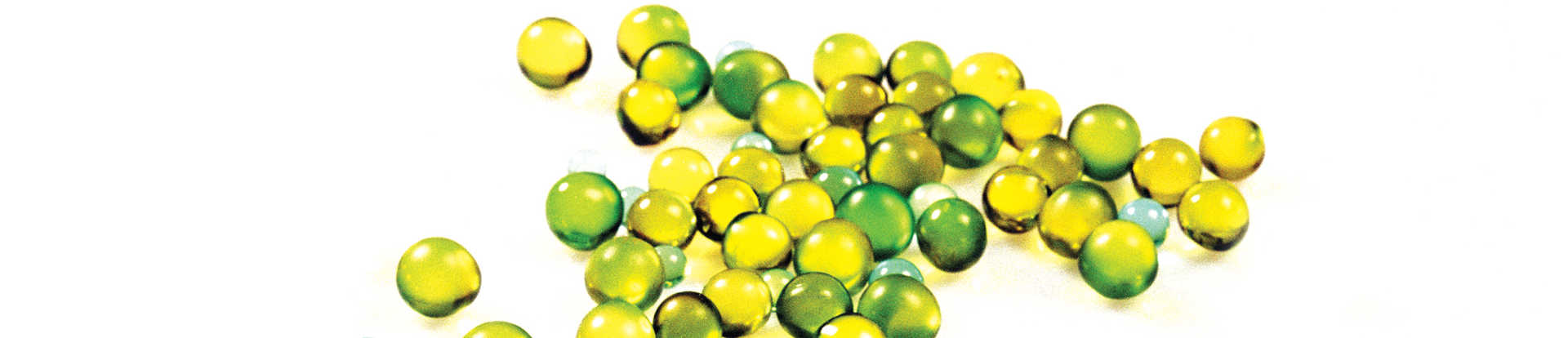 Green, yellow, and blue round orbs spilling across white surface