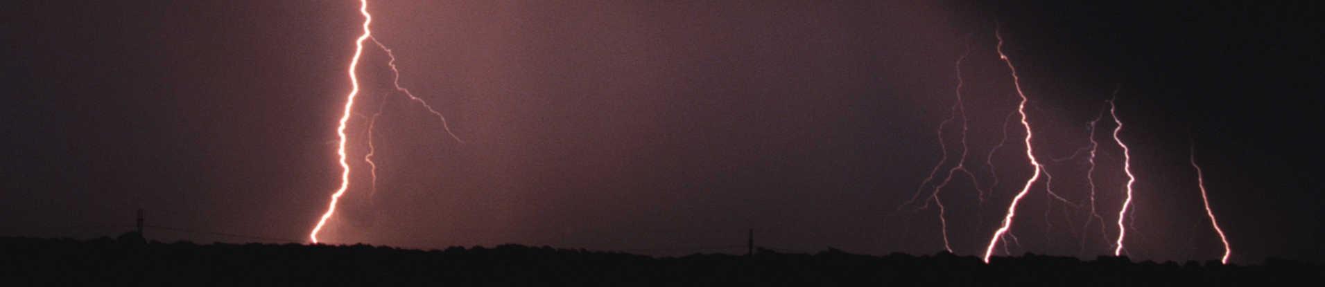 Lightning bolts in dark sky