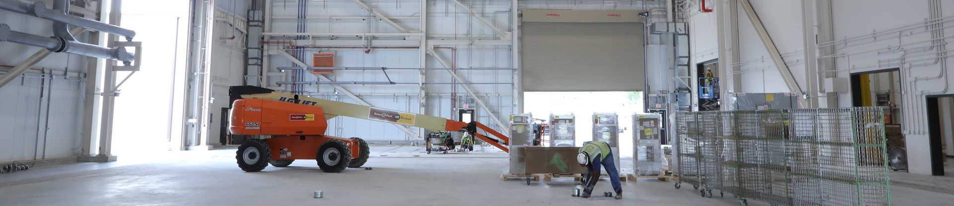 Technician working inside the STEP Pilot Plant