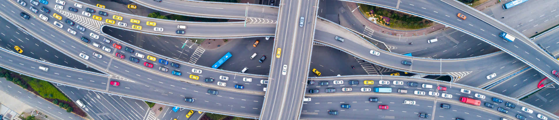 Aerial view of a freeway interchange with many cars on the road