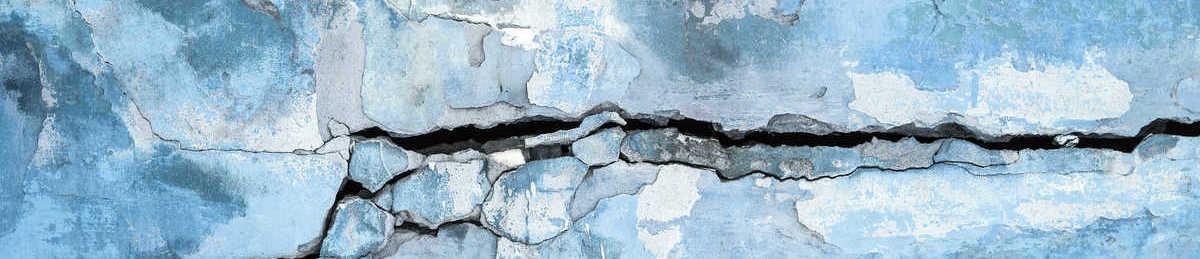 Peeling plastered wall with cracks