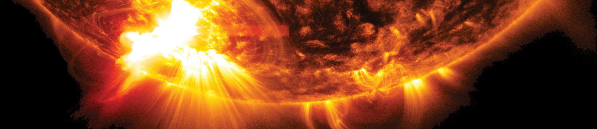 An orange sun with a solar flare