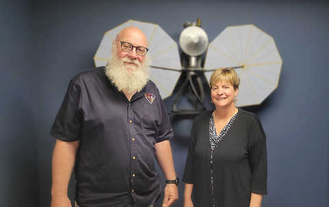 Portrait of Dr. Hal Levison and Dr. Cathy Olkin in front of a Lucy display