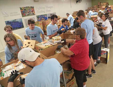 SwRI staff volunteer at the Food Bank