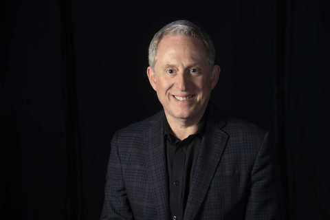 Alan Stern in front of a black background
