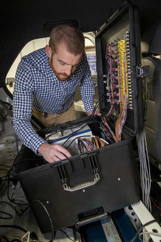 SwRI engineer working on battery performance instrumentation