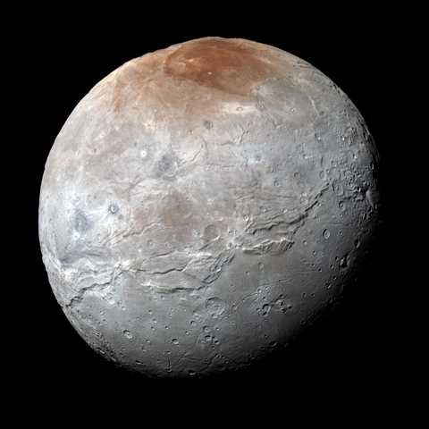 NASA's New Horizons captured this high-resolution enhanced color view of Charon just before closest approach on July 14, 2015