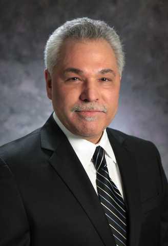 Dr. Christopher J. Freitas