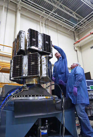 The eight microsatellites that make up the CYGNSS constellation are shown on the deployment module being readied for vibration tests. Vibration testing simulates the environmental conditions the systems will undergo during captive carry on the Orbital-ATK