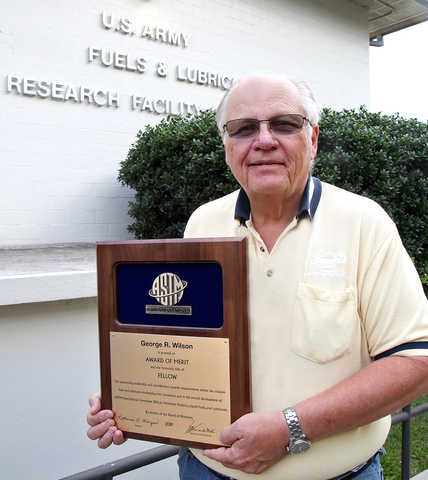 George Wilson, standing and holding the ASTM Award of Merit