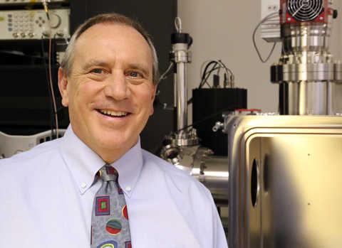 Dr. Hunter Waite standing next to equipment