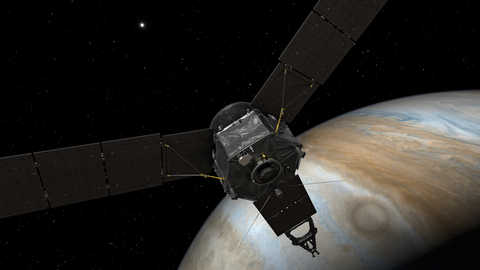An artistic rendering of NASA's Juno spacecraft entering orbit of Jupiter