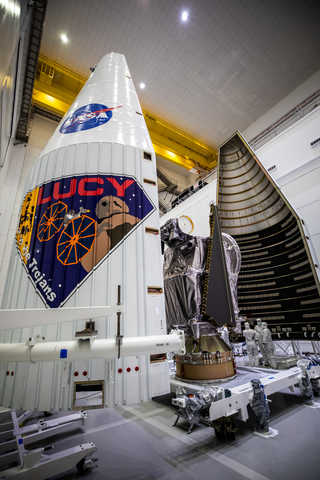 The Lucy spacecraft being tucked into the launch vehicle fairing