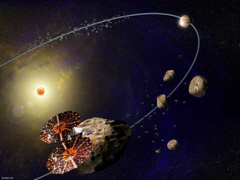 Southwest Research Institute is leading NASA's Lucy mission, which will launch in 2021 for the first reconnaissance of the Trojans, a population of primitive asteroids orbiting in tandem with Jupiter. In this artist's concept (not to scale), the Lucy spac