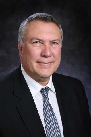 Dr. David McComas