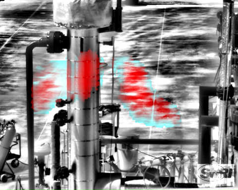 Black and white industrial piping with a blue and red plume of methane in the middle