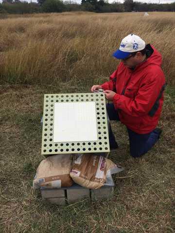 Dr. Marius Necsoiu sets up a Van Atta retroreflector panel