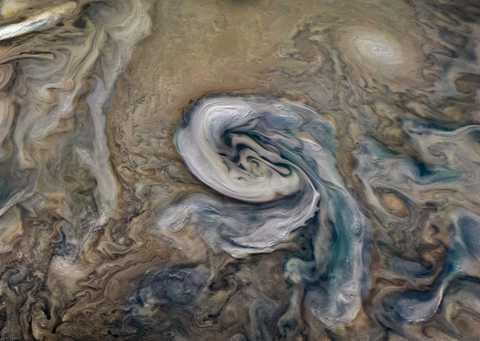 White clouds of ammonia, rotating anticlockwise above Jupiter
