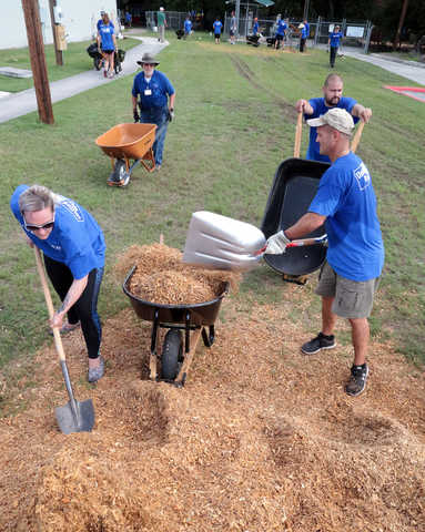 SwRI holds an annual volunteer day to support local United Way agencies. Staff and their family members spend a Saturday helping the community with a variety of projects.