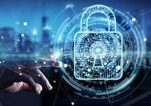 Businessman using digital padlock to secure his data