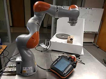 grey robotic arm with orange elbows