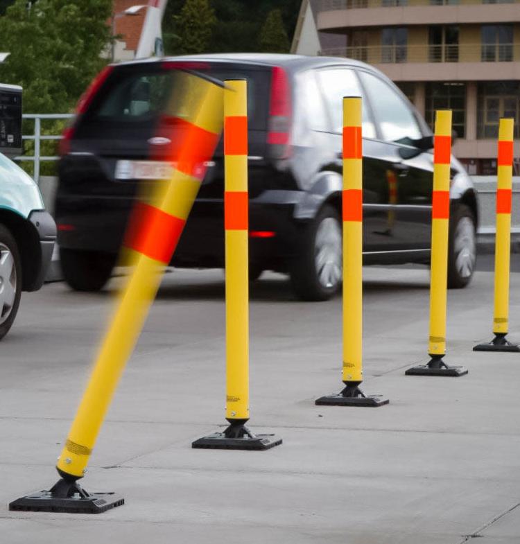 black SUV driving alongside traffic control markers