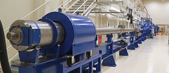 Long metal tube on a blue frame