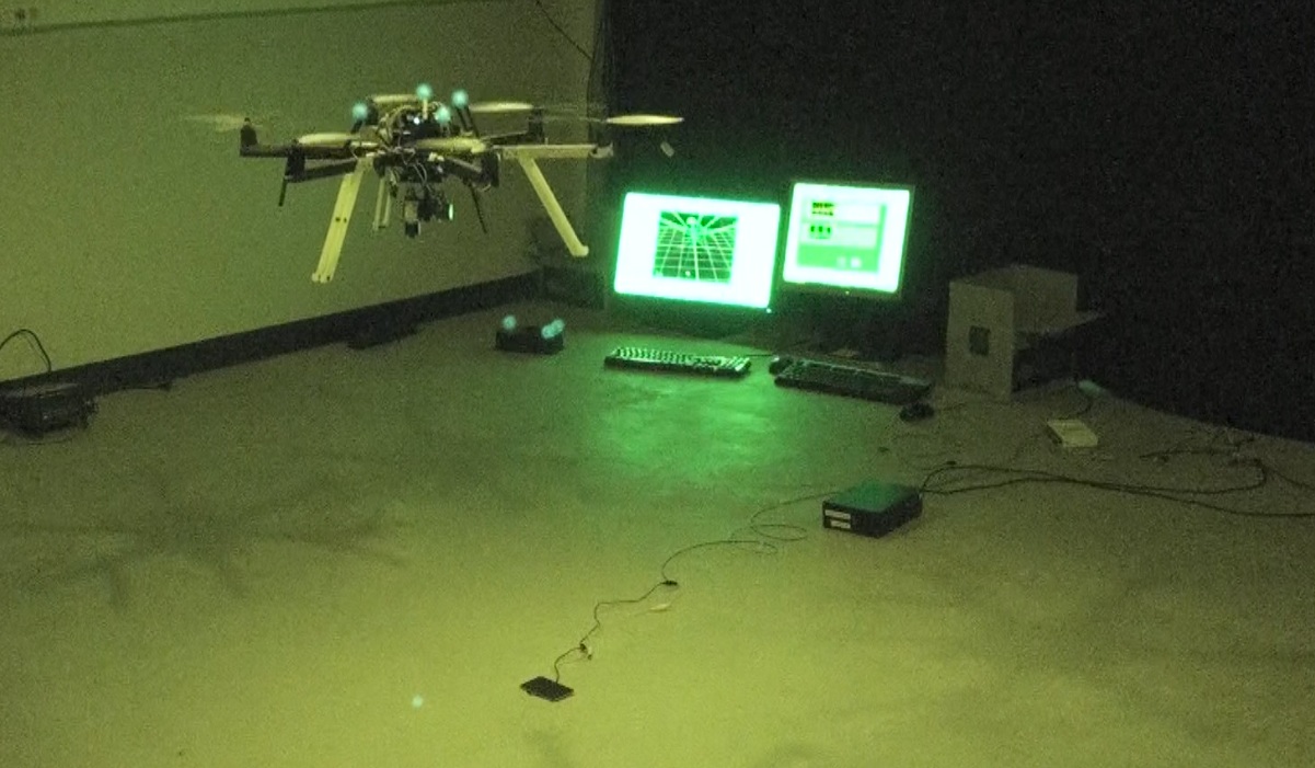 UAS hovering with laser near photovoltaic cell