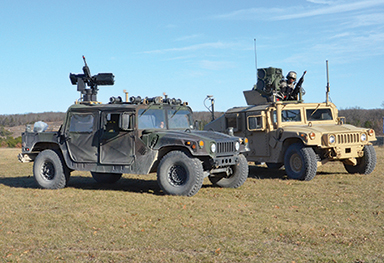 Paired robotic- and soldier-operated vehicles